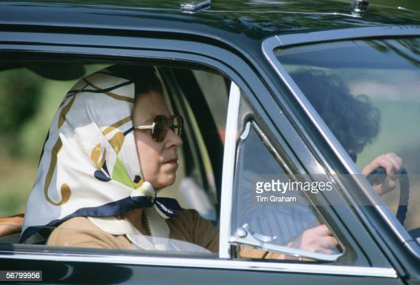 Queen Elizabeth II driving in Windsor Great Park without wearing a seat belt
