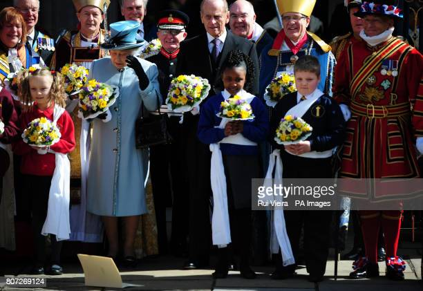 Queen Elizabeth II drops her order of service outside Derby Cathedral after attending the Royal Maundy Service