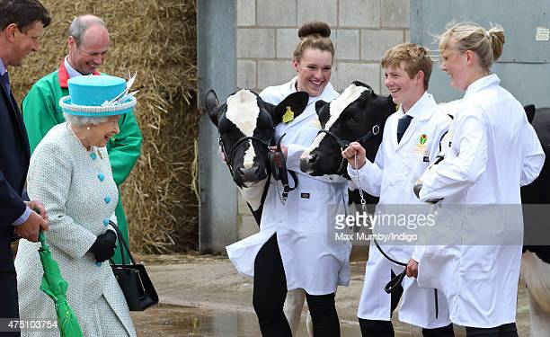 Queen Elizabeth II Duke of Lancaster meets students cows as she visits the dairy yard at Myerscough College on May 29 2015 in Lancaster England