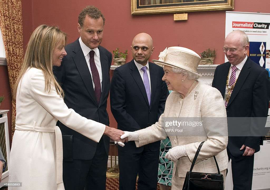 Queen <a gi-track='captionPersonalityLinkClicked' href=/galleries/search?phrase=Elizabeth+II&family=editorial&specificpeople=67226 ng-click='$event.stopPropagation()'>Elizabeth II</a> during a visit to the Journalists' Charity at the Stationers' Hall on May 7, 2014 in London, England. They were met by Lord Rothermere, President, Journalists' Charity and Mr Tom Hempenstall, Master of Stationers' Company, they also met senior media executives, journalists, industry figures and sponsors.
