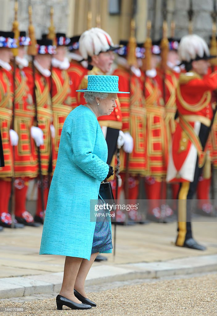 Queen Elizabeth II during an Armed Forces Parade and Muster in Windsor Castle on May 19, 2012 in Windsor, England. More than 2,500 troops, sailors, soldiers and Royal Air Force personnel from nearly all areas of the British Armed Forces were represented in the main body of the parade, together with a tri-Service Guard of Honour and six military bands.