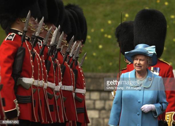 Queen Elizabeth II during inspects The Queen's Company of The Grenadier Guards at Windsor Castle The Queen was amused today when a rival swarm of...