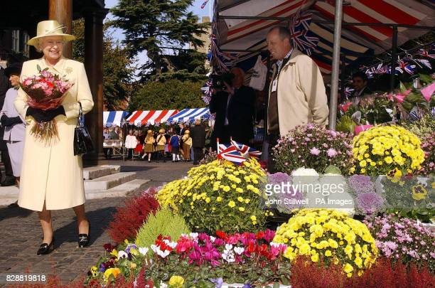 Queen Elizabeth II during the tour of the market square in Enfield Town centre London During the visit the Queen and the Duke of Edinburgh will...