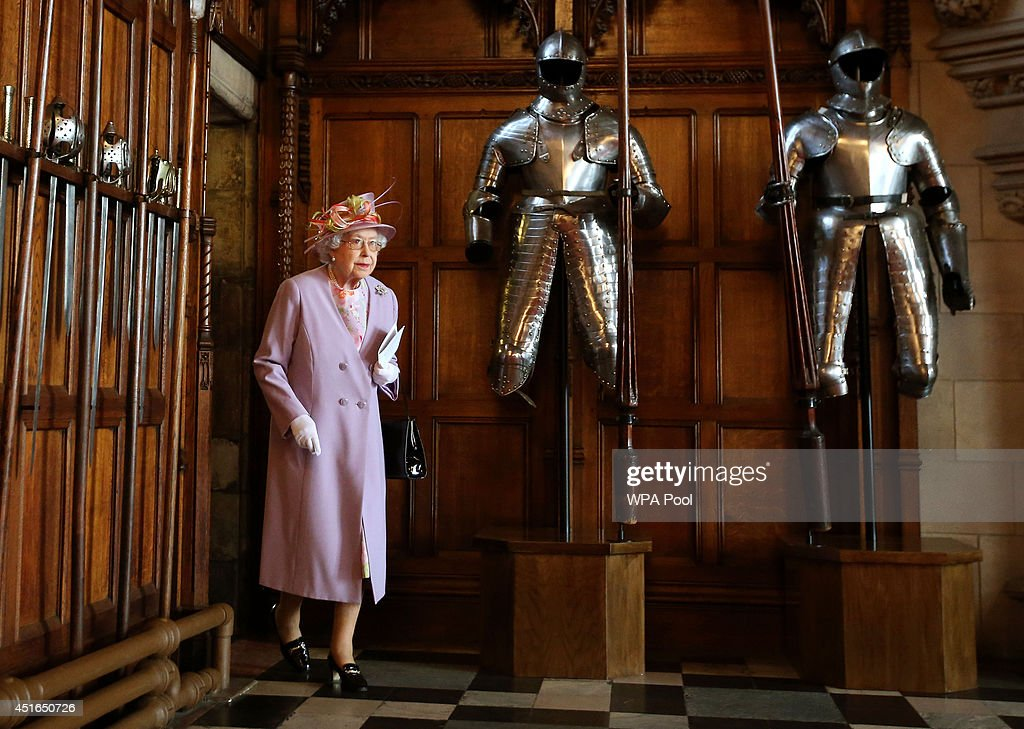 Queen <a gi-track='captionPersonalityLinkClicked' href=/galleries/search?phrase=Elizabeth+II&family=editorial&specificpeople=67226 ng-click='$event.stopPropagation()'>Elizabeth II</a> enters the Great Hall at Edinburgh Castle to meet those associated with the Memorial after attending a commemorative service for the Scottish National War Memorial at Edinburgh Castle on July 3, 2014 in Edinburgh, Scotland, United Kingdom.