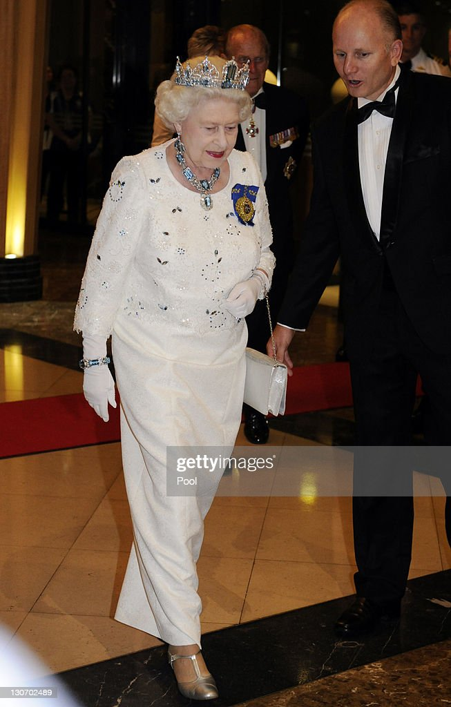 Queen Elizabeth II, escorted by Pan Pacific Perth hotel General Manager Grant Raubenheimer, arrives for a banquet as part of the Commonwealth Heads of Government Meeting (CHOGM) on October 28, 2011 in Perth, Australia. Queen Elizabeth II opened the 54-nation summit today, following a 9-day tour of Australia. The three-day biennial gathering is chaired by Australian Prime Minister, Julia Gillard and concludes on October 30.