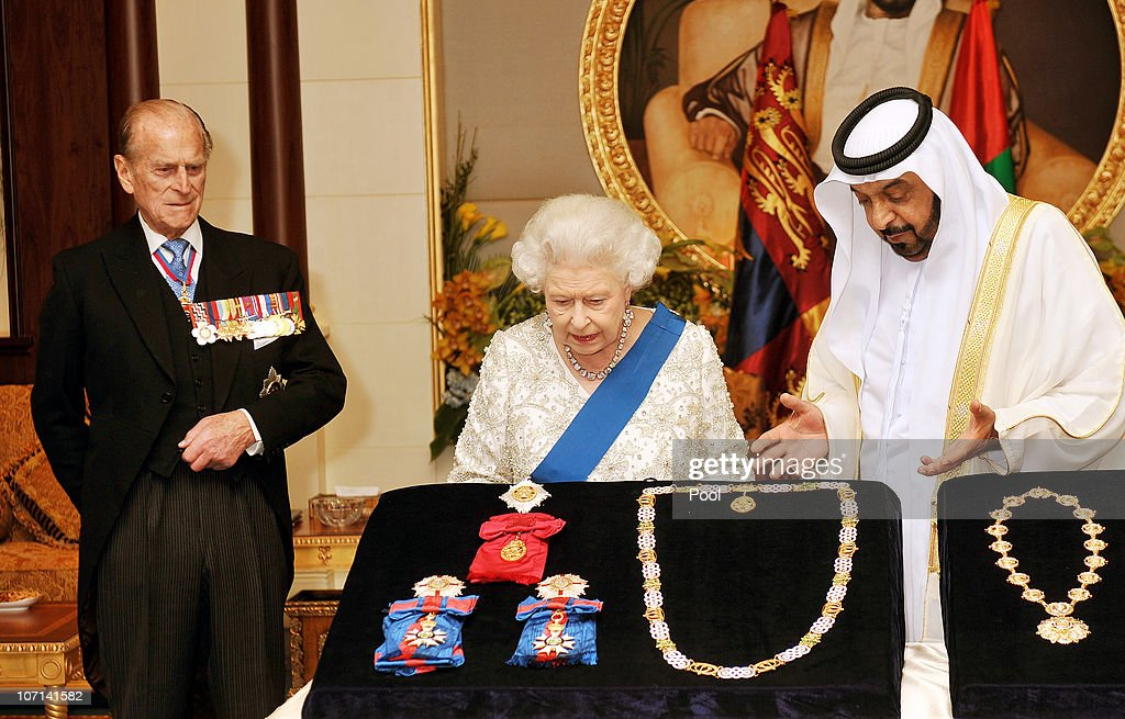 Queen Elizabeth II exchanges gifts with the President of the United Arab Emirates, Sheikh Khalifa Bin Zayed al Nahyan as Prince Philip, Duke of Edinburgh (left) watches at the Mushrif Palace on November 25, 2010 in Abu Dhabi, United Arab Emirates. Queen Elizabeth II and Prince Philip, Duke of Edinburgh are in Abu Dhabi on a State Visit to the Middle East. The Royal couple will spend two days in Abu Dhabi and three days in Oman.