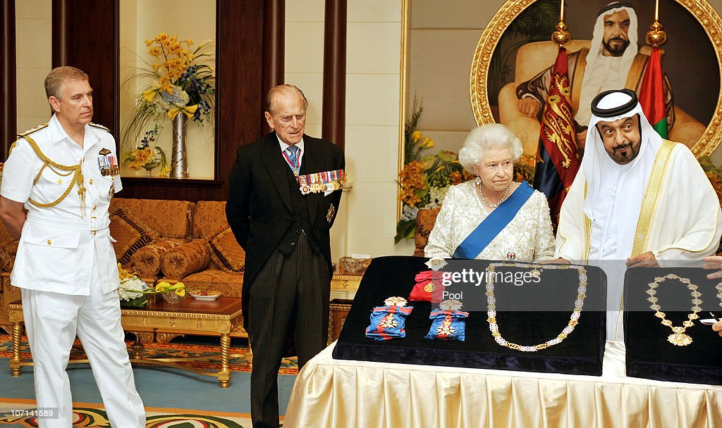 Queen Elizabeth II exchanges gifts with the President of the United Arab Emirates, Sheikh Khalifa Bin Zayed al Nahyan as Prince Philip, Duke of Edinburgh and Prince Andrew, Duke of York watch at the Mushrif Palace on November 25, 2010 in Abu Dhabi, United Arab Emirates. Queen Elizabeth II and Prince Philip, Duke of Edinburgh are in Abu Dhabi on a State Visit to the Middle East. The Royal couple will spend two days in Abu Dhabi and three days in Oman.