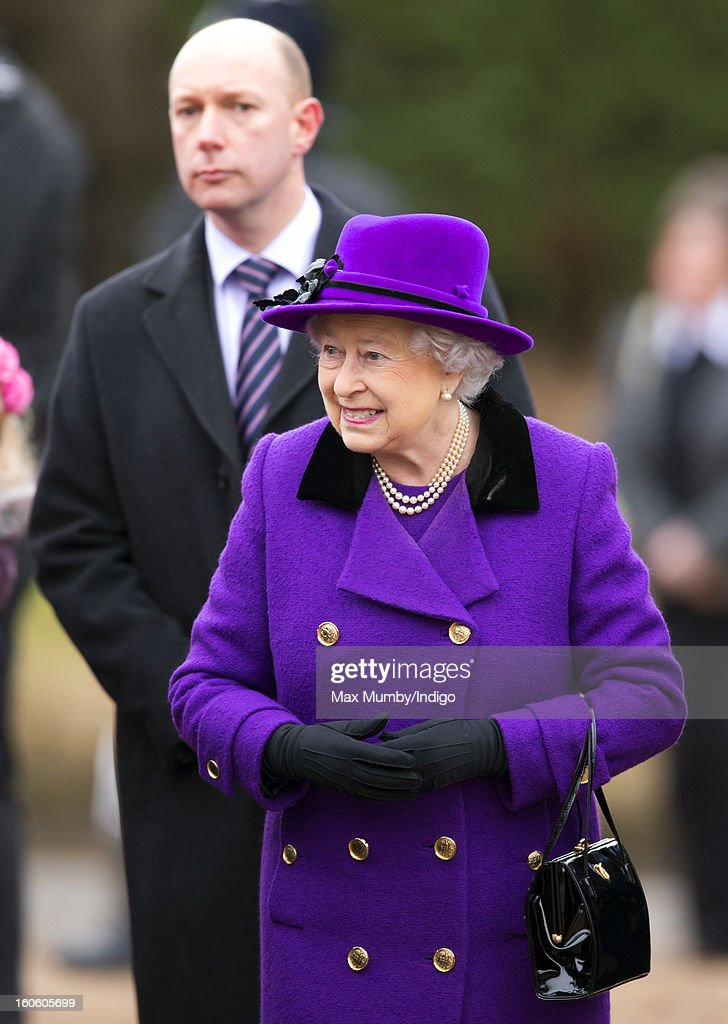 Queen Elizabeth II, flanked by a police protection officer, undertakes a walkabout after attending Sunday service at the church of St Peter and St Paul in West Newton on February 03, 2013 near King's Lynn, England.