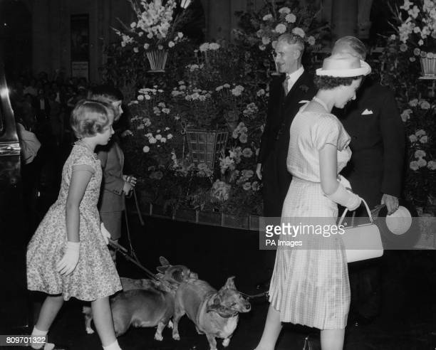 Queen Elizabeth II followed by her children the Prince of Wales and Princess Anne and the Royal family's pet corgis at Euston Station when they left...
