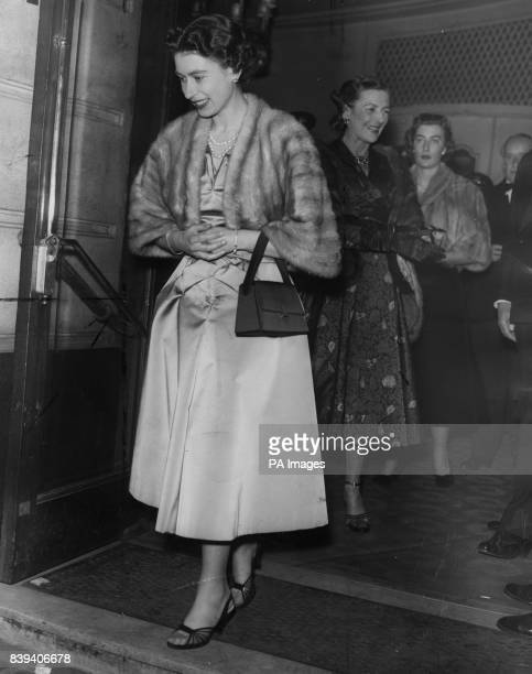 Queen Elizabeth II followed by Lady Mountbatten leaves the Piccadilly Theatre London after watching Peter Ustinov's play 'Romanoff and Juliet'