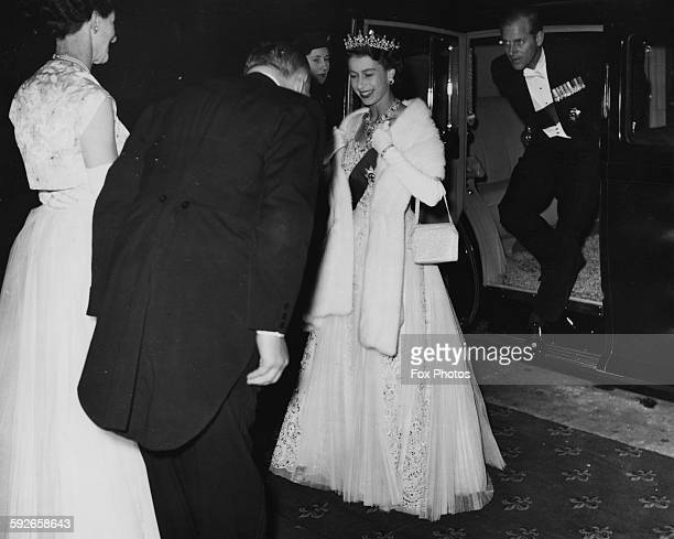 Queen Elizabeth II followed by the Duke of Edinburgh wearing formal dress as they are greeted by Hon T Playford and his wife on their arrival at...