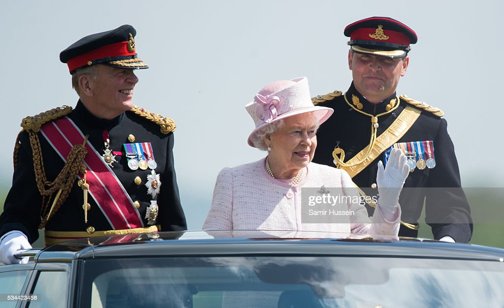 Queen Elizabeth II, General-Captain of the Royal Regiment of Artillery, overseas a Royal Review on the occasion of their Tercentenary at Knighton Down on May 26, 2016 in Lark Hill, England.