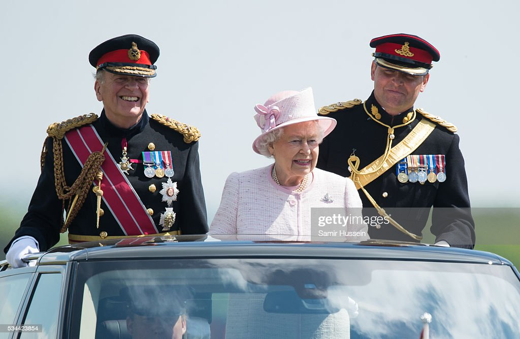 Queen <a gi-track='captionPersonalityLinkClicked' href=/galleries/search?phrase=Elizabeth+II&family=editorial&specificpeople=67226 ng-click='$event.stopPropagation()'>Elizabeth II</a>, General-Captain of the Royal Regiment of Artillery, overseas a Royal Review on the occasion of their Tercentenary at Knighton Down on May 26, 2016 in Lark Hill, England.