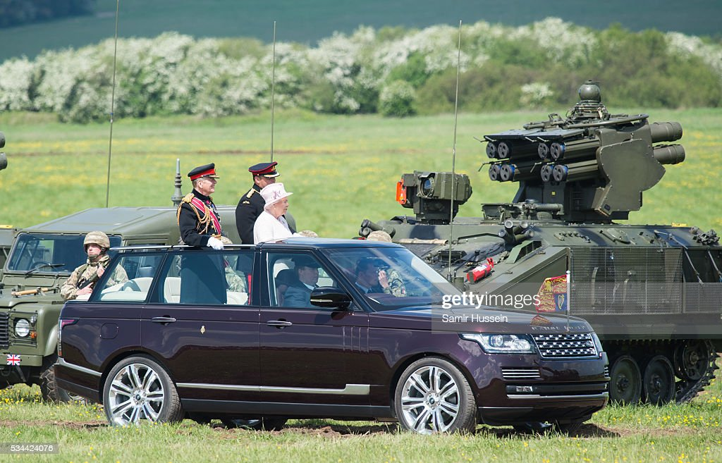 Queen <a gi-track='captionPersonalityLinkClicked' href=/galleries/search?phrase=Elizabeth+II&family=editorial&specificpeople=67226 ng-click='$event.stopPropagation()'>Elizabeth II</a>, General-Captain of the Royal Regiment of Artillery, rides in an open top Range Rover as she overseas a Royal Review on the occasion of their Tercentenary at Knighton Down on May 26, 2016 in Lark Hill, England.