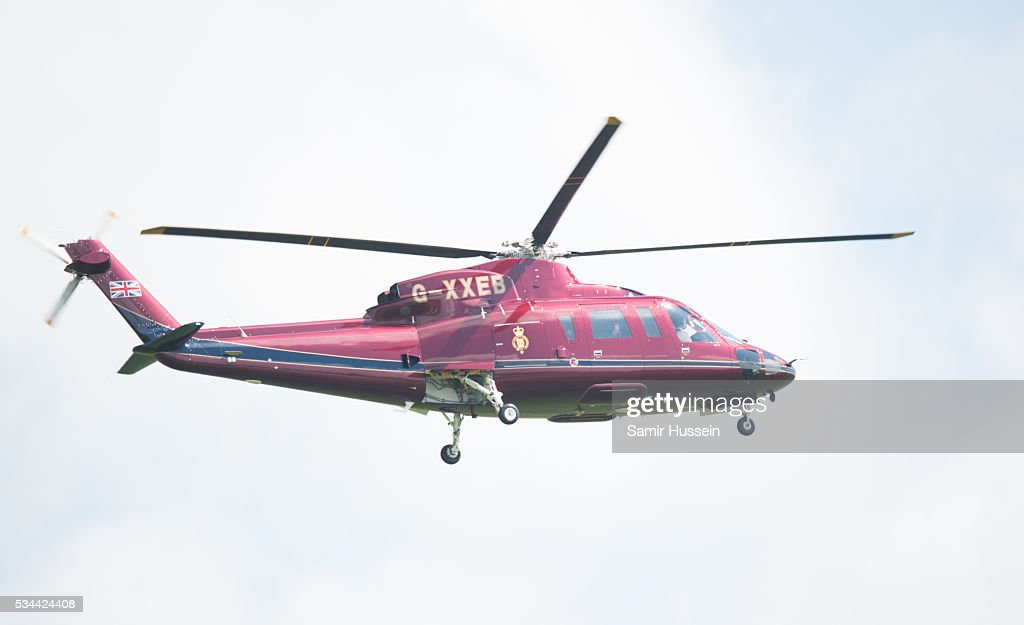 Queen Elizabeth II, General-Captain of the Royal Regiment of Artillery, arrives by helicopter as she overseas a Royal Review on the occasion of their Tercentenary at Knighton Down on May 26, 2016 in Lark Hill, England.