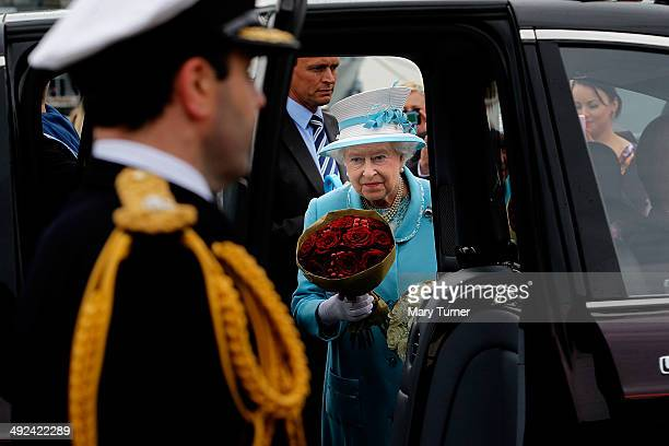 Queen Elizabeth II gets into her car before being driven away from Portsmouth Naval Base where she visited HMS Lancaster on May 20 2014 in Portsmouth...