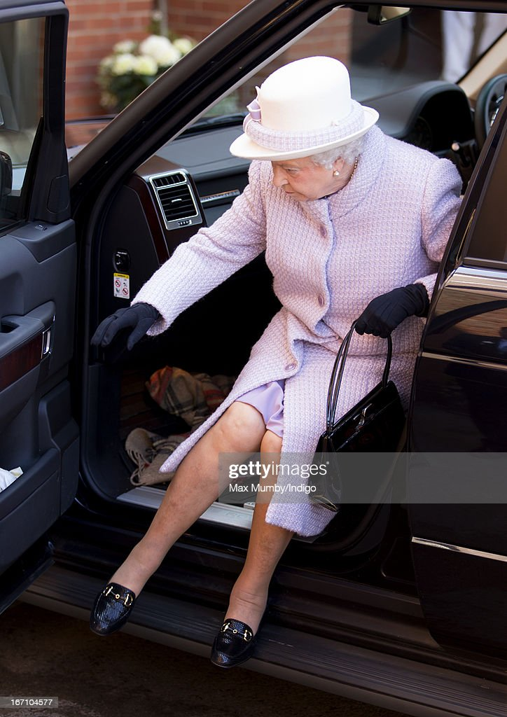 Queen Elizabeth II gets out a Range Rover car as she arrives at Newbury Racecourse to attend the New to Racing Day at on April 20, 2013 in Newbury, England.