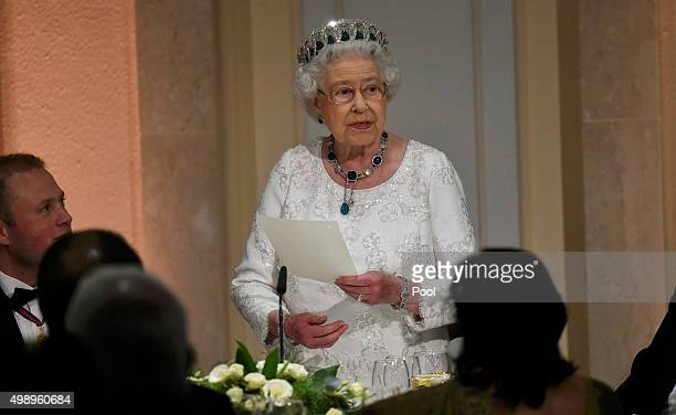 Queen Elizabeth II gives a speech as she attends a dinner at the Corinthia Palace Hotel in Attard during the Commonwealth Heads of Government Meeting...