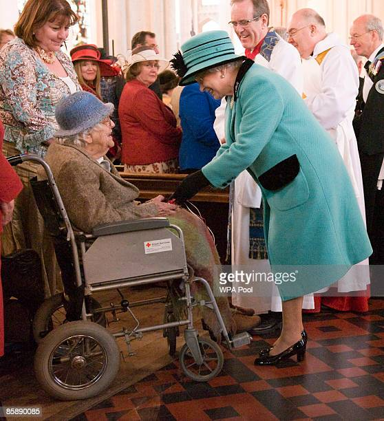 Queen Elizabeth II greets a member of the congregation as she attends the Royal Maundy Service at St Edmundsbury Catherderal on April 9 2009 in Bury...