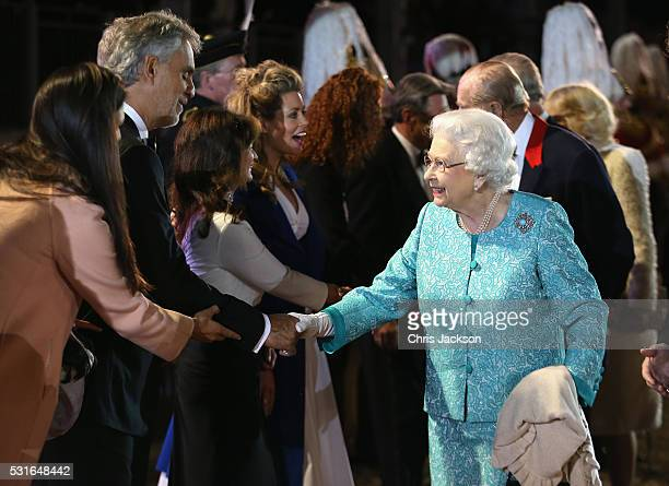 Queen Elizabeth II greets Andrea Bocelli as she attends the final night of her 90th Birthday Celebrations at Windsor on May 15 2016 in Windsor England