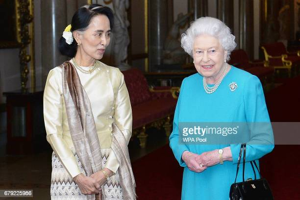 Queen Elizabeth II greets Burma's de facto leader Aung San Suu Kyi ahead of a private lunch at Buckingham Palace on May 5 2017 in London England