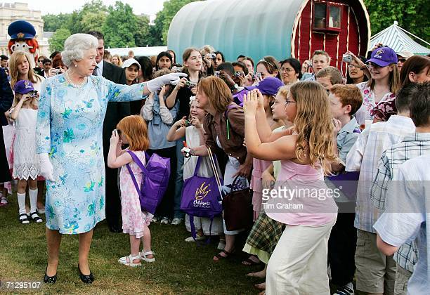 Queen Elizabeth II greets children at the Children's Party at the Palace a children's literacy garden party hosted by the Queen to celebrate her 80th...