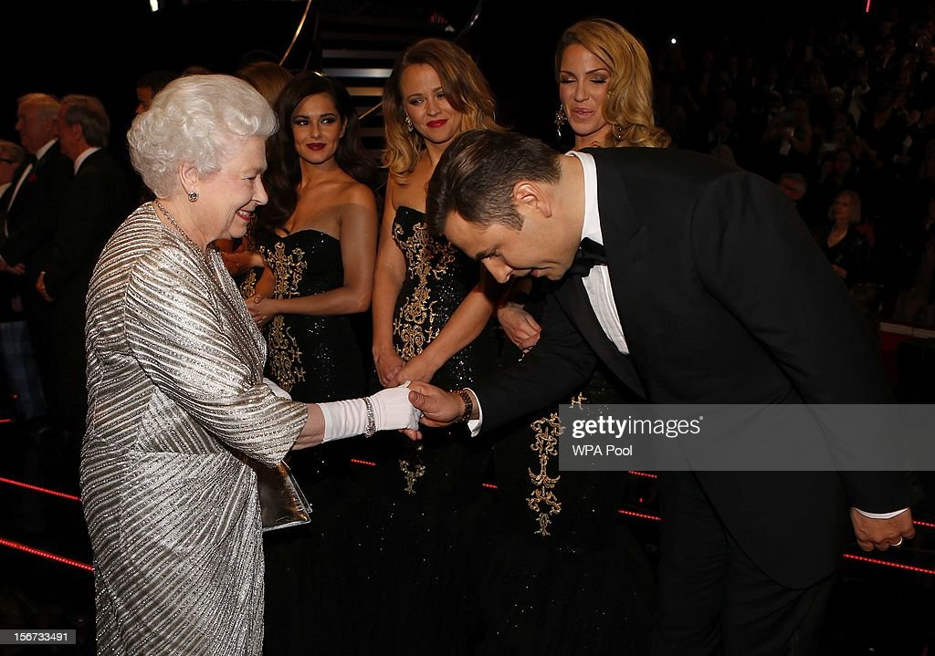 Queen Elizabeth II greets comedian <a gi-track='captionPersonalityLinkClicked' href=/galleries/search?phrase=David+Walliams&family=editorial&specificpeople=203020 ng-click='$event.stopPropagation()'>David Walliams</a> at the Royal Variety Performance at the Royal Albert Hall on November 19, 2012 in in London, United Kingdom.