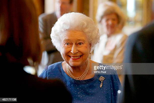 Queen Elizabeth II greets guests at a reception for winners of The Queen's Awards for Enterprise 2014 at Buckingham Palace on July 14 2014 in London...