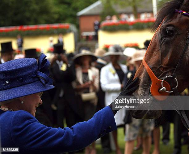 Queen Elizabeth II greets her horse Free Agent after it landed The Chesham Stakes Race run at Ascot Racecourse on June 21 in Ascot England Today was...