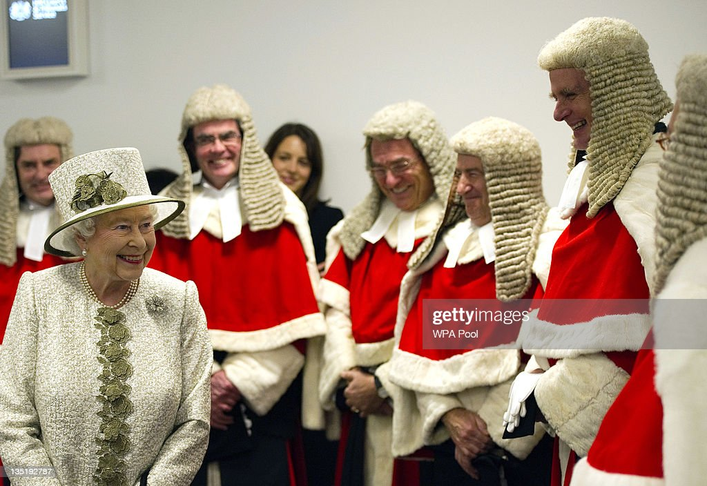Queen Elizabeth II greets High Court judges as she officially opens the Rolls Building, the latest addition to the Royal Courts of Justice, on December 7, 2011 in London, England. (Photo by Adrian Dennis - WPA Pool/Getty Images)