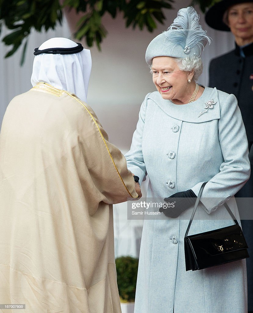 Queen Elizabeth II greets His Highness the Amir Sheikh <a gi-track='captionPersonalityLinkClicked' href=/galleries/search?phrase=Sabah+Al-Ahmad+Al-Jaber+Al-Sabah&family=editorial&specificpeople=5573991 ng-click='$event.stopPropagation()'>Sabah Al-Ahmad Al-Jaber Al-Sabah</a> of Kuwait at a Ceremonial Welcome Windsor Castle on November 27, 2012 in Windsor, England.