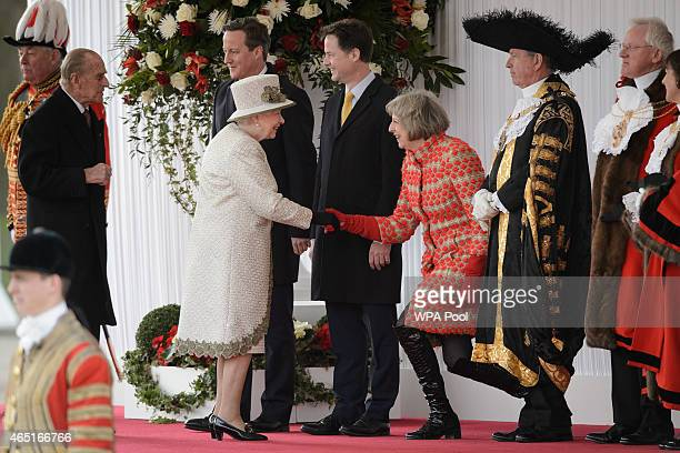 Queen Elizabeth II greets Home Secretary Theresa May as they await the arrival of the President of Mexico Enrique Pena Nieto and his wife Angelica...