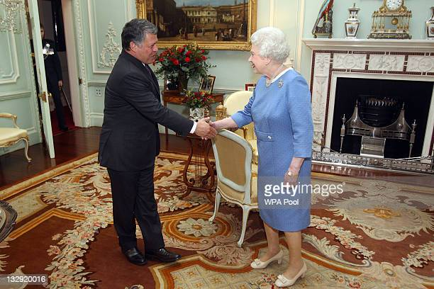 Queen Elizabeth II greets King Abdullah II of Jordan at Buckingham Palace on November 15 2011 in London England The King was on an official visit to...