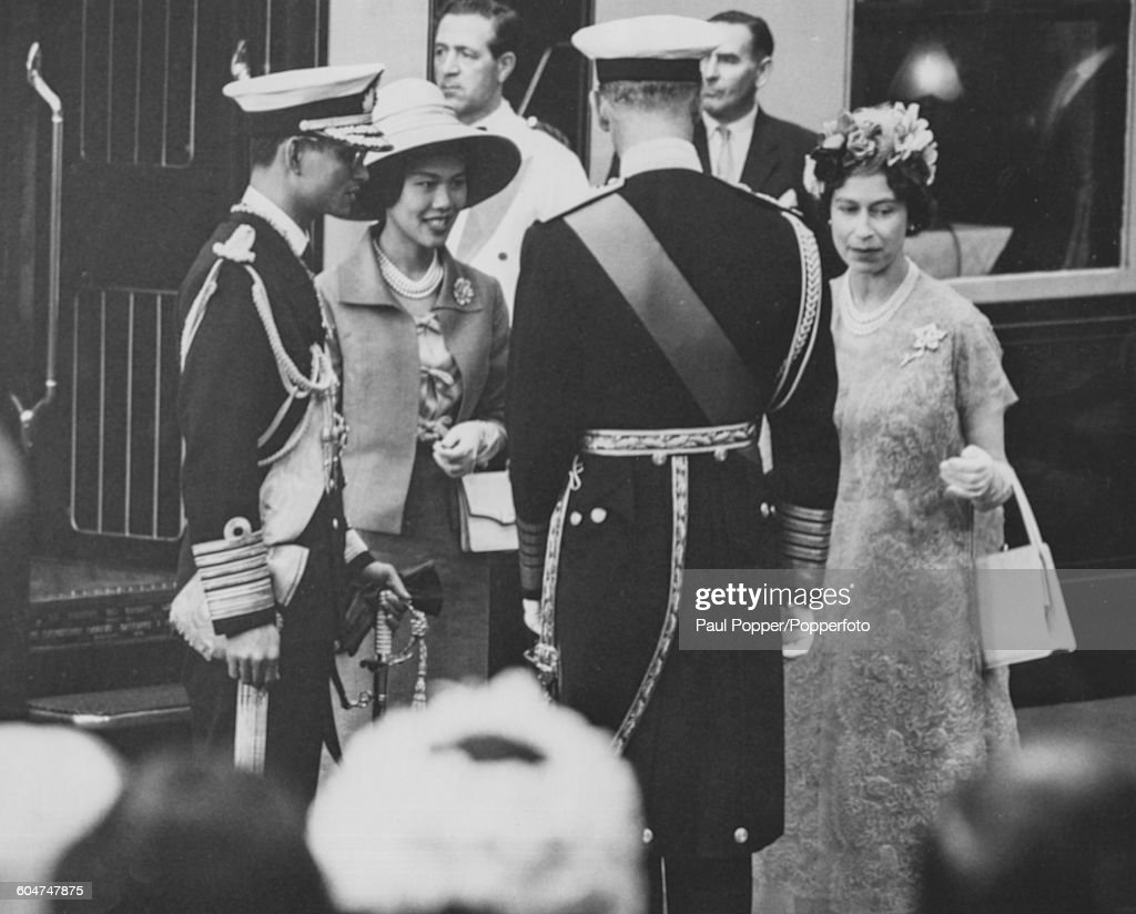 Queen <a gi-track='captionPersonalityLinkClicked' href=/galleries/search?phrase=Elizabeth+II&family=editorial&specificpeople=67226 ng-click='$event.stopPropagation()'>Elizabeth II</a> (right) greets King Bhumibol Adulyadej of Thailand (left) as Queen <a gi-track='captionPersonalityLinkClicked' href=/galleries/search?phrase=Sirikit&family=editorial&specificpeople=228360 ng-click='$event.stopPropagation()'>Sirikit</a> (second left) and <a gi-track='captionPersonalityLinkClicked' href=/galleries/search?phrase=Prince+Philip&family=editorial&specificpeople=92394 ng-click='$event.stopPropagation()'>Prince Philip</a> (back to camera) look on, at Victoria Station in London at the start of a three day State Visit on July 19th 1960.