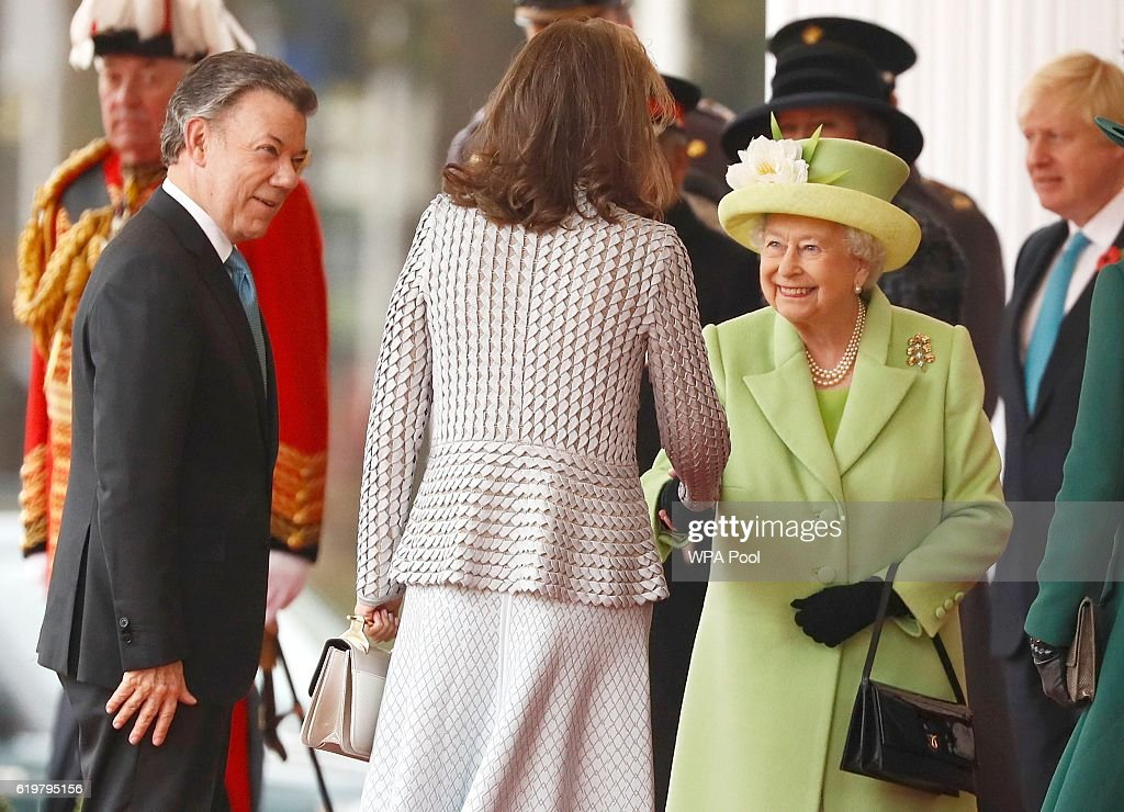 Queen Elizabeth II greets Maria Clemencia de Santos as her husband Colombia's President Juan Manuel Santos looks on at a ceremonial welcome for Colombia's President Juan Manuel Santos and his wife Maria Clemencia de Santos at Horse Guards Parade on November 1, 2016 in London, England. The President is on a state visit to Britain.