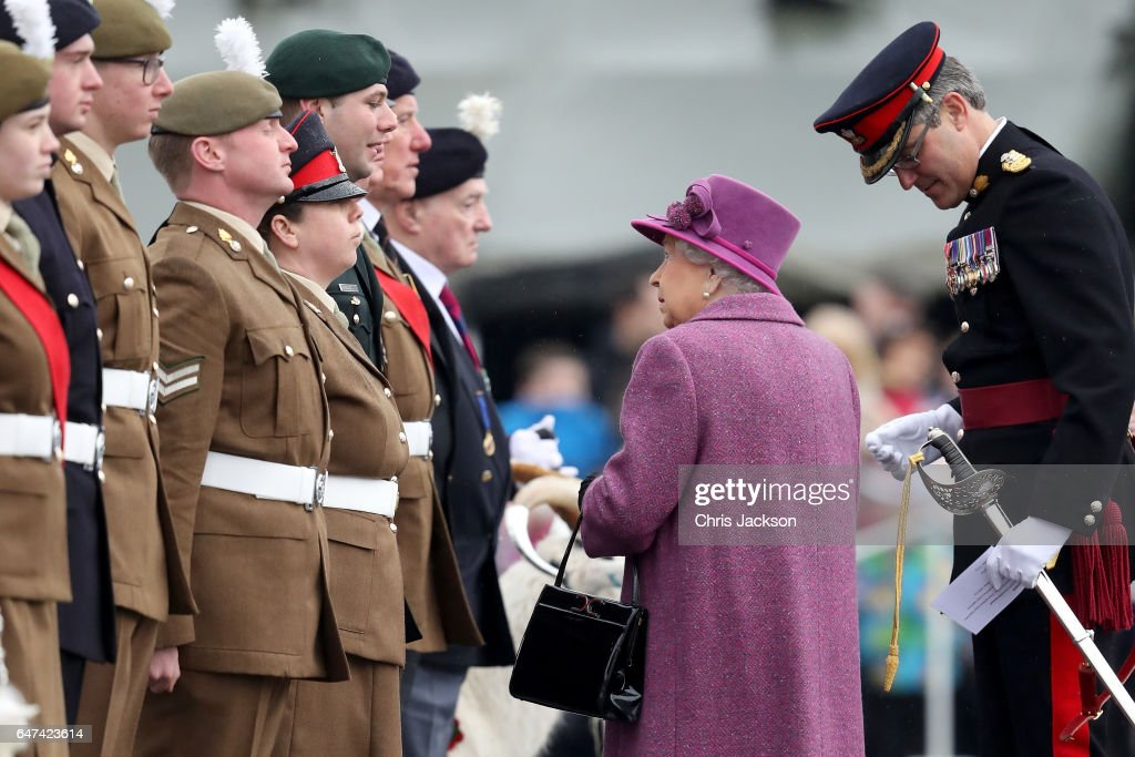 queen-elizabeth-ii-greets-members-of-the-royal-welsh-as-she-attends-a-picture-id647423614