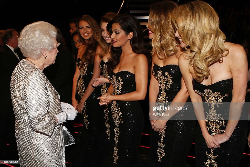 Queen Elizabeth II greets (L-R) Nadine Coyle, Nicola Roberts, Cheryl Cole, Kimberley Walsh and Sarah Harding from 'Girls Aloud' at the Royal Variety Performance at the Royal Albert Hall on November 19, 2012 in in London, United Kingdom.