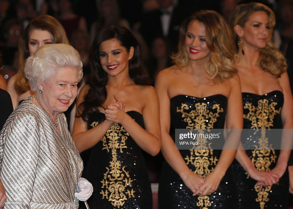 Queen Elizabeth II greets (L-R) Nicola Roberts, Cheryl Cole, Kimberley Walsh and Sarah Harding from 'Girls Aloud' at the Royal Variety Performance at the Royal Albert Hall on November 19, 2012 in in London, United Kingdom.