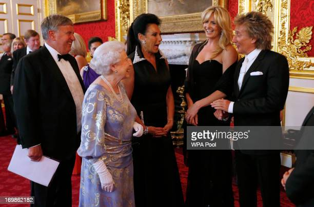 Queen Elizabeth II greets Penny Lancaster and Rod Stewart during a reception for the Royal National Institute for the Blind at St James Palace on...