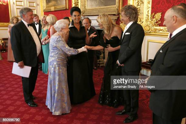 Queen Elizabeth II greets Penny Lancaster and Rod Stewart during a reception for the Royal National Institute for the Blind held at St James Palace...