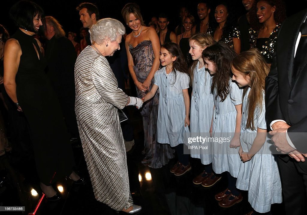 Queen <a gi-track='captionPersonalityLinkClicked' href=/galleries/search?phrase=Elizabeth+II&family=editorial&specificpeople=67226 ng-click='$event.stopPropagation()'>Elizabeth II</a> greets performers from the musical 'Matilda' at the Royal Variety Performance at the Royal Albert Hall on November 19, 2012 in in London, United Kingdom.