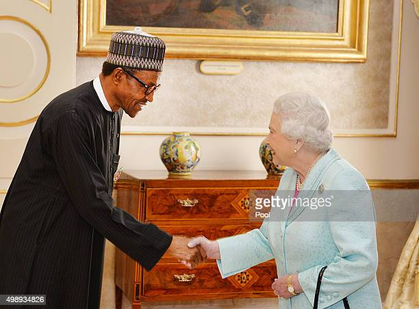 Queen Elizabeth II greets President Muhammadu Buhari of Nigeria during a Heads of Government reception at the San Anton Palace on November 27 2015...