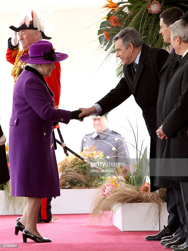 HM Queen <a gi-track='captionPersonalityLinkClicked' href=/galleries/search?phrase=Elizabeth+II&family=editorial&specificpeople=67226 ng-click='$event.stopPropagation()'>Elizabeth II</a> greets Prime Minister <a gi-track='captionPersonalityLinkClicked' href=/galleries/search?phrase=Gordon+Brown&family=editorial&specificpeople=158992 ng-click='$event.stopPropagation()'>Gordon Brown</a> during a ceremonial welcome for South Africa President Jacob Zuma on Horseguards Parade on March 3, 2010 in London, England. The South African Leader is on a three day State visit to Britain.