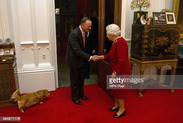 Queen Elizabeth II greets Prime Minister of New Zealand John Key at a audience held at Windsor Castle on October 29 2015 in Windsor England