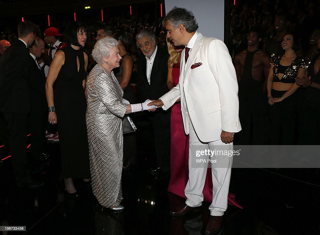 Queen Elizabeth II greets singer <a gi-track='captionPersonalityLinkClicked' href=/galleries/search?phrase=Andrea+Bocelli&family=editorial&specificpeople=211558 ng-click='$event.stopPropagation()'>Andrea Bocelli</a> (R) as Placido Domingo (C) looks on at the Royal Variety Performance at the Royal Albert Hall on November 19, 2012 in in London, United Kingdom.