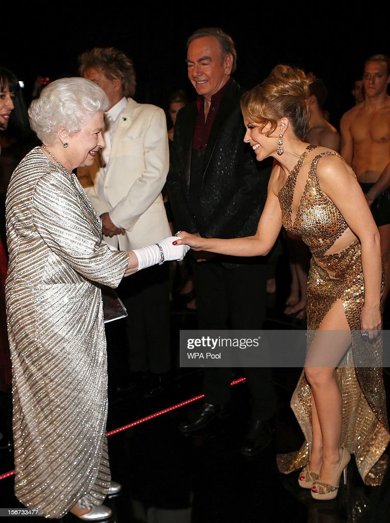 Queen Elizabeth II greets singer Kylie Minogue as singer Neil Diamond looks on at the Royal Variety Performance at the Royal Albert Hall on November 19, 2012 in in London, United Kingdom.