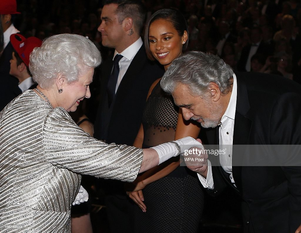 Queen Elizabeth II greets tenor Placido Domingo as singer <a gi-track='captionPersonalityLinkClicked' href=/galleries/search?phrase=Alicia+Keys&family=editorial&specificpeople=169877 ng-click='$event.stopPropagation()'>Alicia Keys</a> looks on at the Royal Variety Performance at the Royal Albert Hall on November 19, 2012 in in London, United Kingdom.