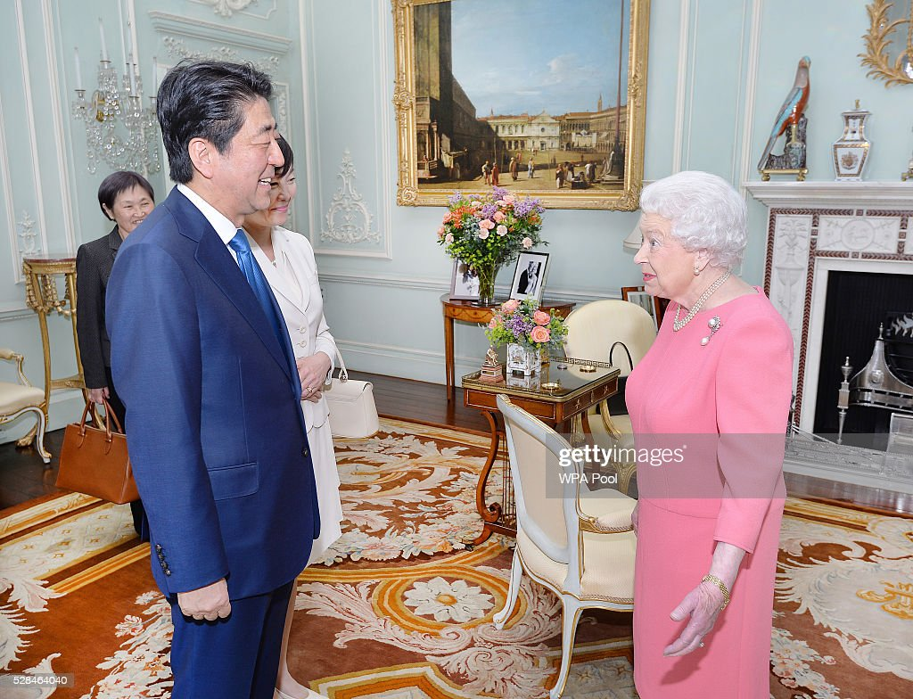 Queen Elizabeth II greets the Prime Minister of Japan Shinzo Abe and wife Akie after they arrived for a private audience at Buckingham Palace on May 4, 2016 in London, United Kingdom.