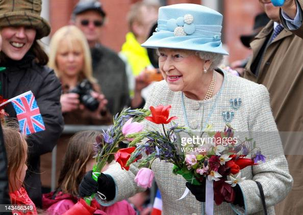 Queen Elizabeth II greets well wishers at the refurbished General Offices of the former steelworks in Ebbw Vale to view documents of the Gwent...