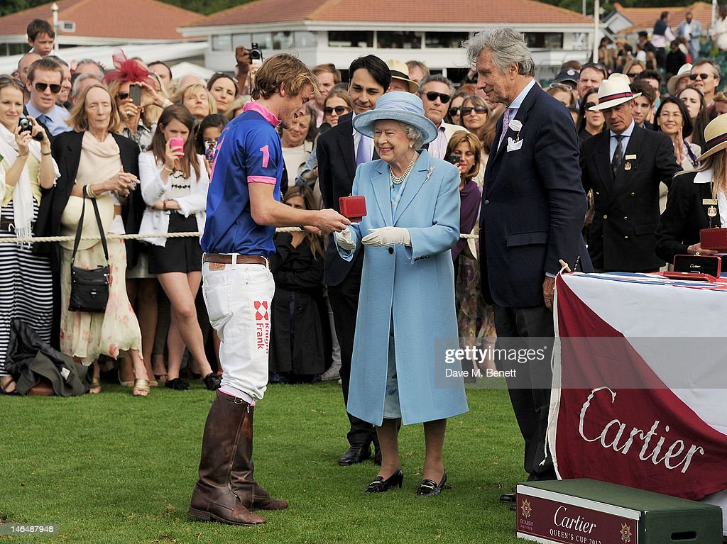 Queen <a gi-track='captionPersonalityLinkClicked' href=/galleries/search?phrase=Elizabeth+II&family=editorial&specificpeople=67226 ng-click='$event.stopPropagation()'>Elizabeth II</a> hand out prizes to players with Cartier Managing Director Francois Le Troquer and Executive Chairman of Cartier UK <a gi-track='captionPersonalityLinkClicked' href=/galleries/search?phrase=Arnaud+Bamberger&family=editorial&specificpeople=227439 ng-click='$event.stopPropagation()'>Arnaud Bamberger</a> at the Cartier Queen's Cup Polo Day 2012 at Guards Polo Club on June 17, 2012 in Egham, England.